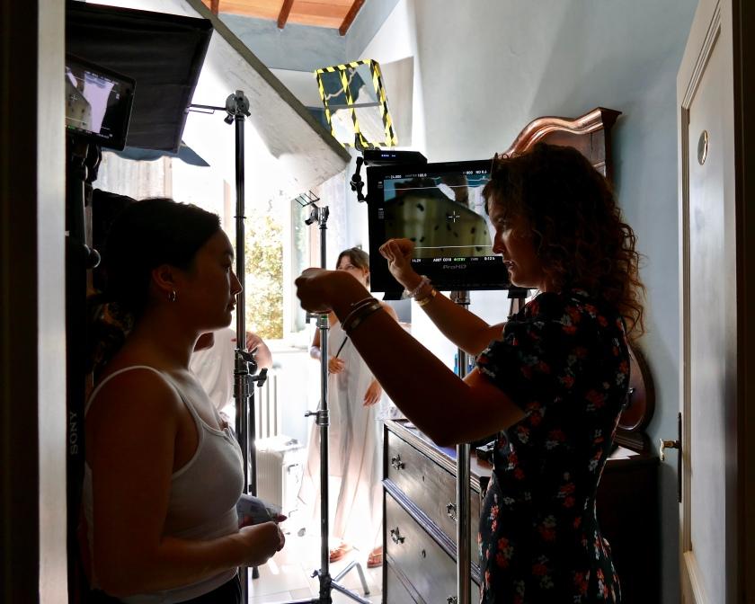 "Elaine on the set of ""Drowned"" talking to director Daria Kocherova"