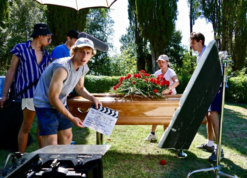 "Elaine adjusting props on the set of ""Drowned"""
